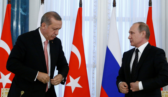 Russian President Vladimir Putin and Turkish President Tayyip Erdogan attend a news conference following their meeting in St. Petersburg